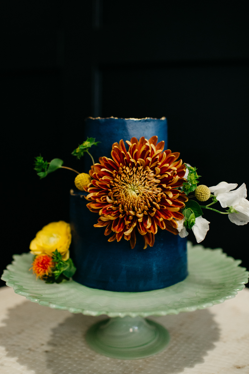 wes anderson inspired wedding styled shoot columbia south carolina small cake with floral garnishes
