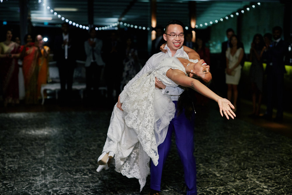 Daniel listing Hasara up off the dance floor at their wedding reception in Sydney Australia