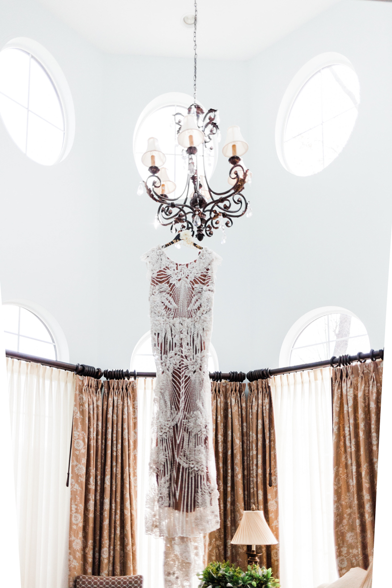 Glam wedding river walk south carolina gown hanging from hotel chandelier