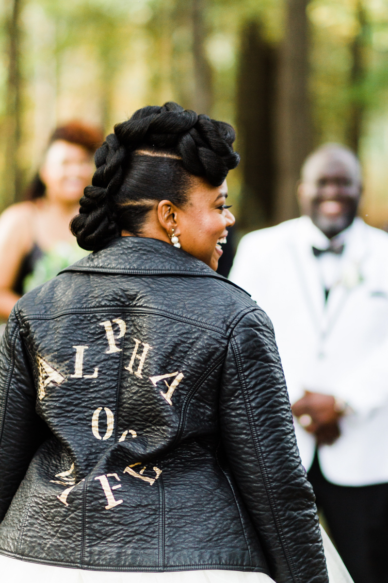 "glam wedding river walk south carolina back of dana's leather jacket reading ""alpha wife for life"""