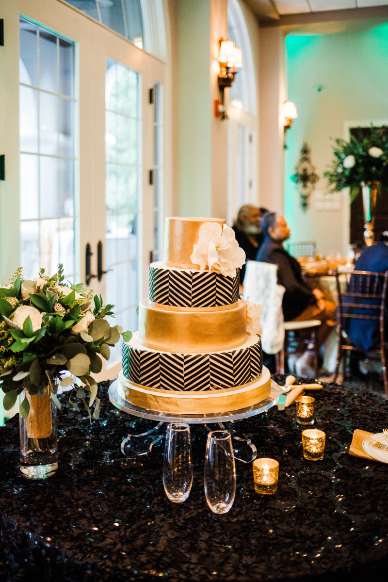glam wedding river walk south carolina gold and chevron-patterned cake