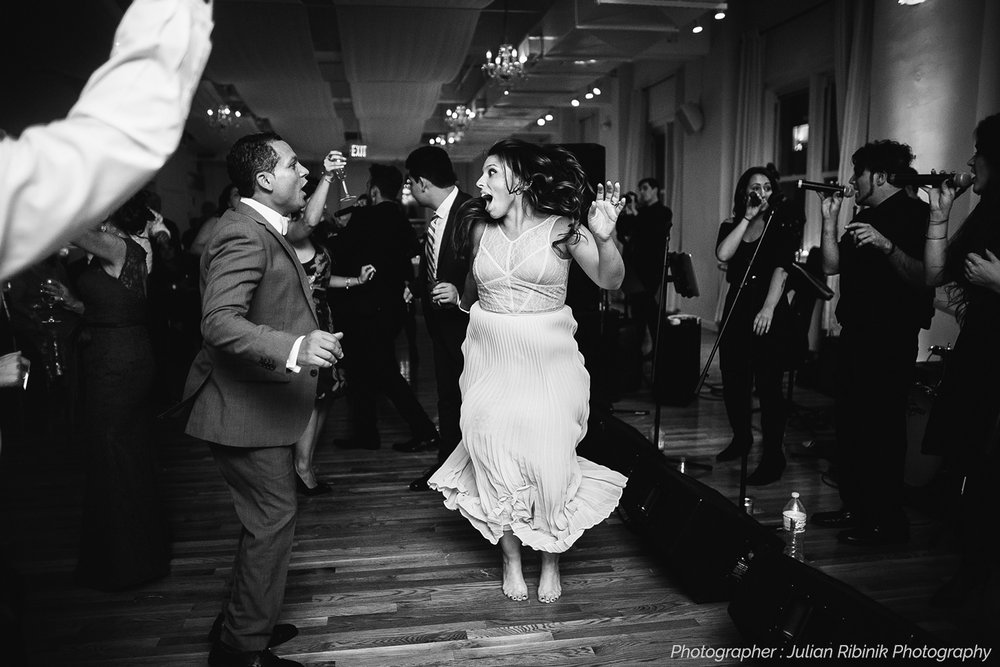 groom and bride dancing barefoot at wedding reception The Metropolitan Players NYC