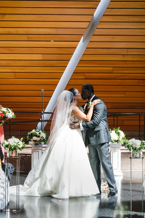 african american, christian, and muslim traditions minneapolis wedding couple kiss during ceremony