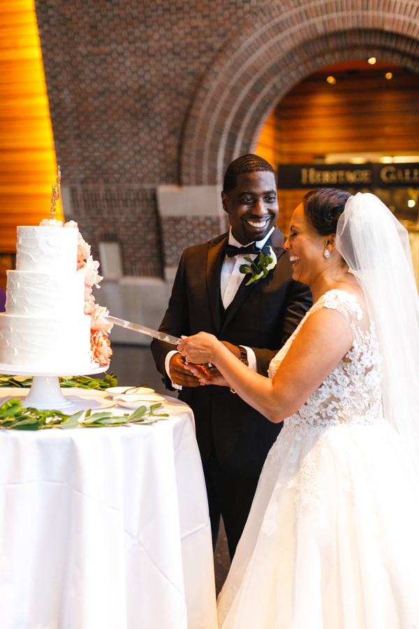 african american, christian, and muslim traditions minneapolis wedding glenn and taara cutting cake