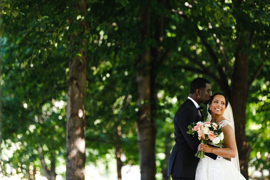 african american, christian, and muslim traditions minneapolis wedding couple in garden
