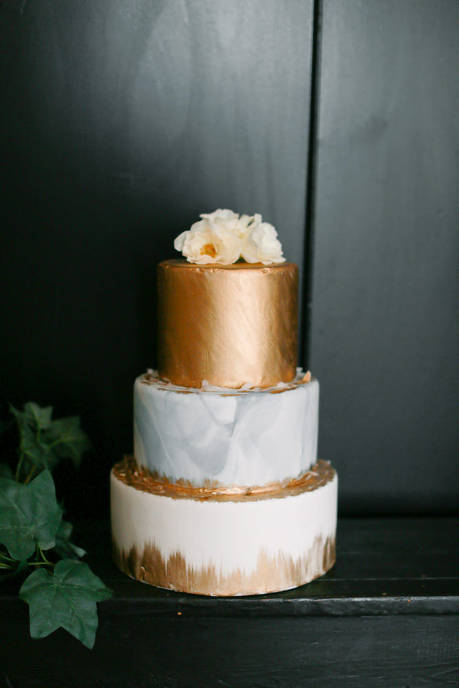 Modern traditional blended styled shoot new york cake topped with flowers