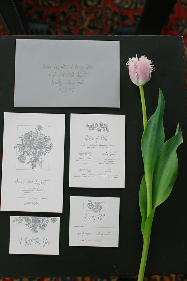 Modern traditional blended styled shoot new york calligraphy set 2 on table with tulip