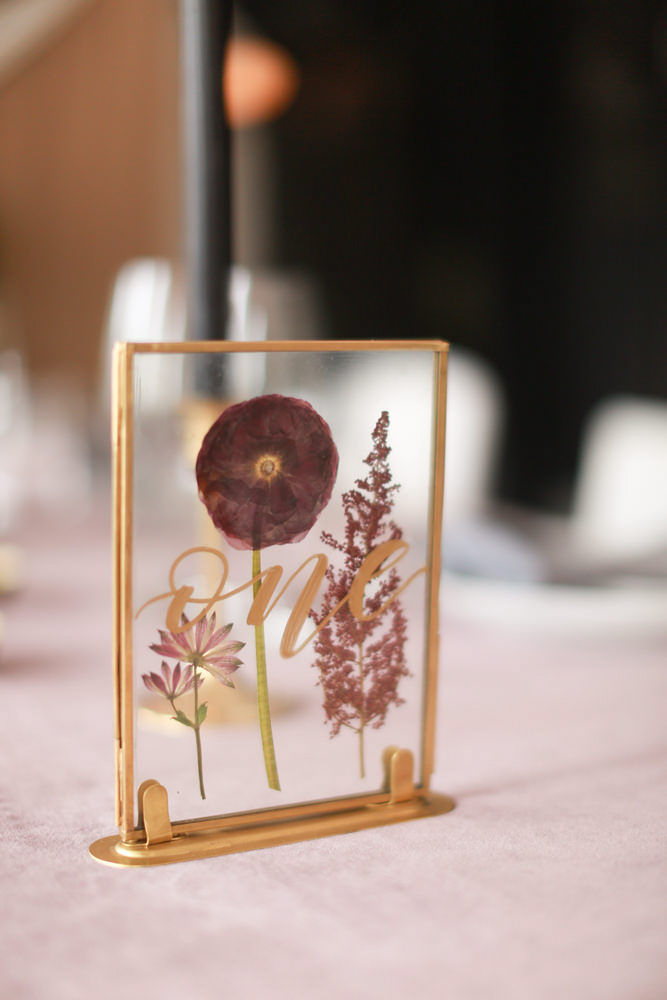 "Modern traditional blended styled shoot new york pressed flower table frame reading ""one"""