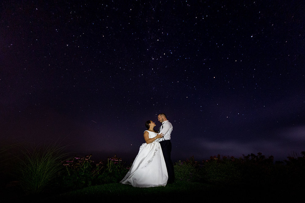 newlywed couple dancing under the stars in the country by nyc wedding photographer Justin McCallum