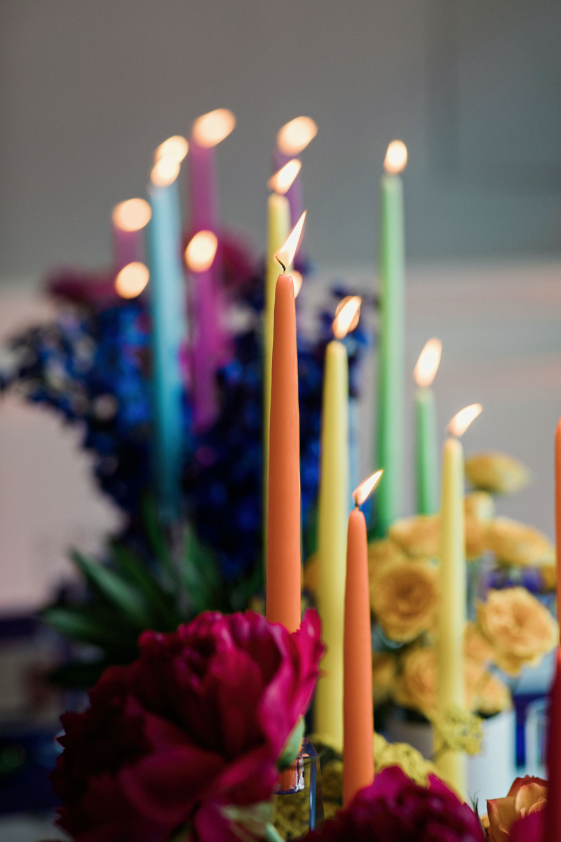 80s themed pride party brooklyn new york taper candles and flowers in assorted colors