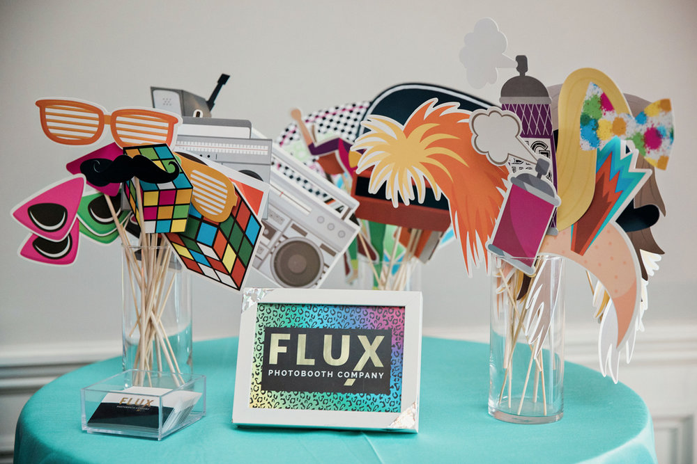 """80s themed pride party brooklyn new york table of photo booth props, card reading """"flux photobooth company"""""""