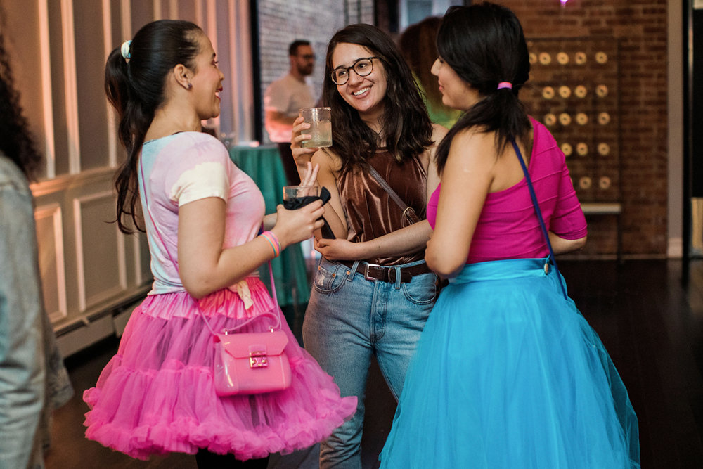 80s themed pride party brooklyn new york party guests wearing colorful tutus and ponytails