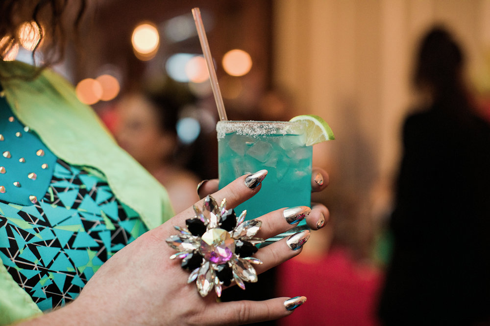 80s themed pride party brooklyn new york guest holding electric drink holding large chunky ring