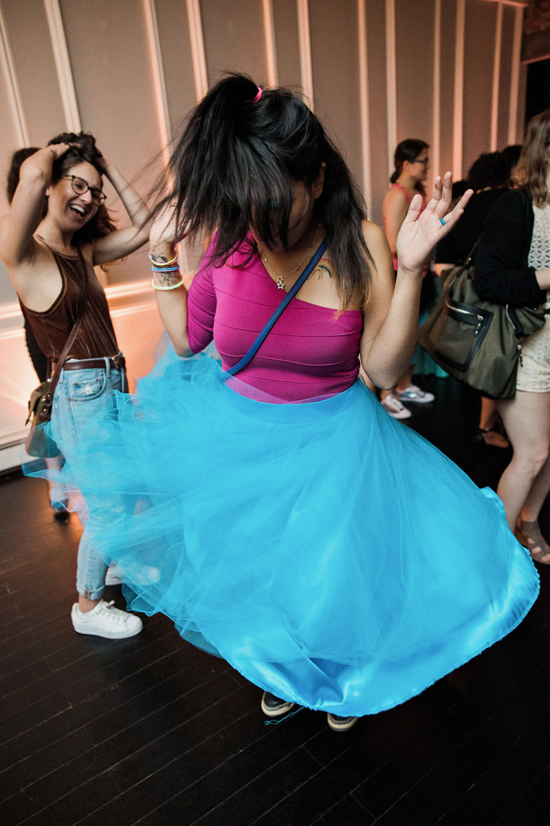 80s themed pride party brooklyn new york guest on dance floor twirling in bright skirt