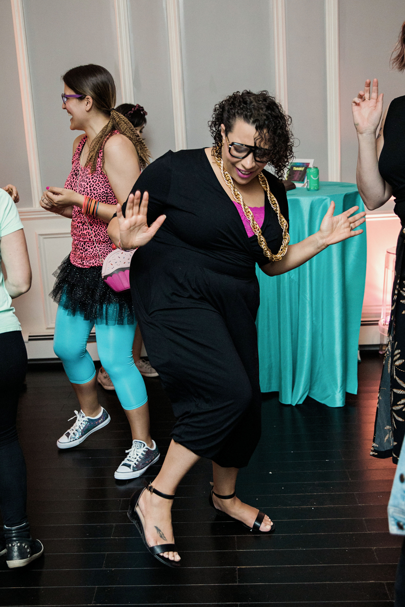 80s themed pride party brooklyn new york guest in large gold chain on dance floor