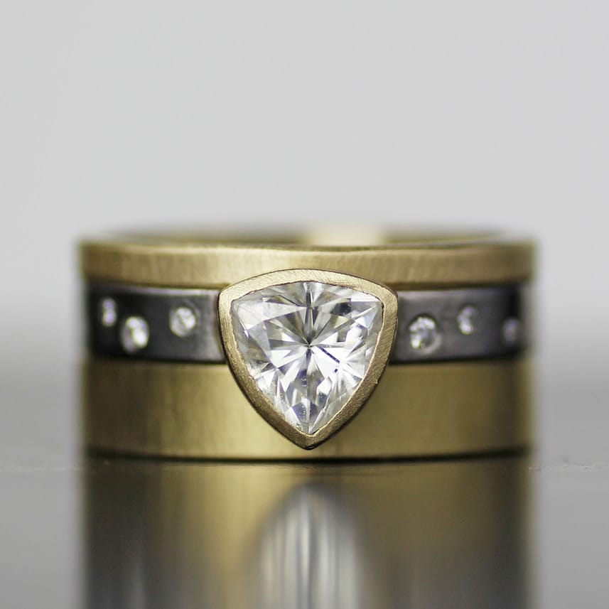 mixed metal silver and gold wedding band with small diamonds and solitaire setting