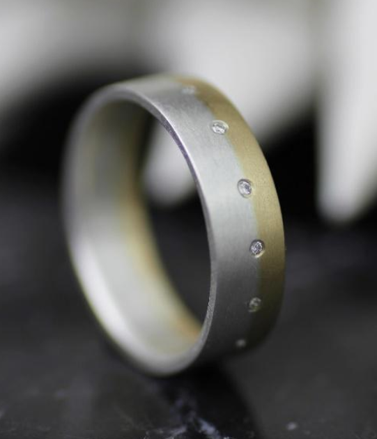 Mixed metals wedding band with diamonds