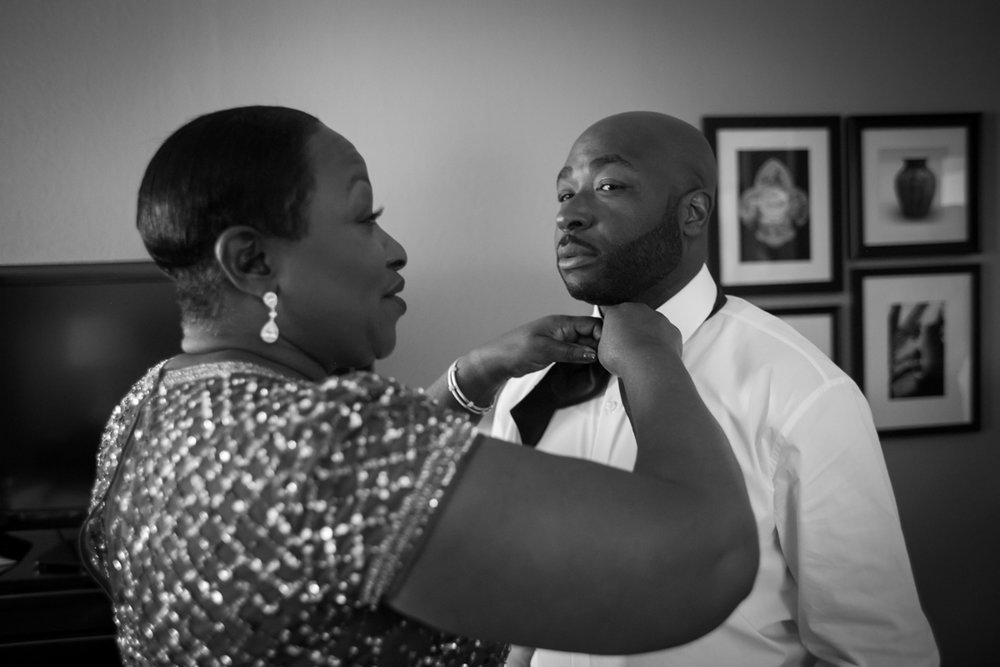 New Orleans Destination Wedding darius having bow tie tied