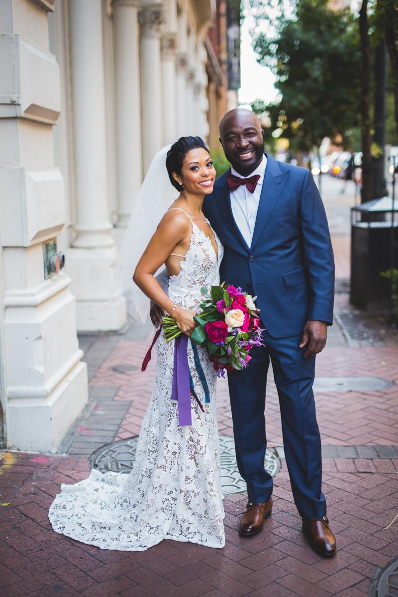 New Orleans Destination Wedding couple smiling on brick path