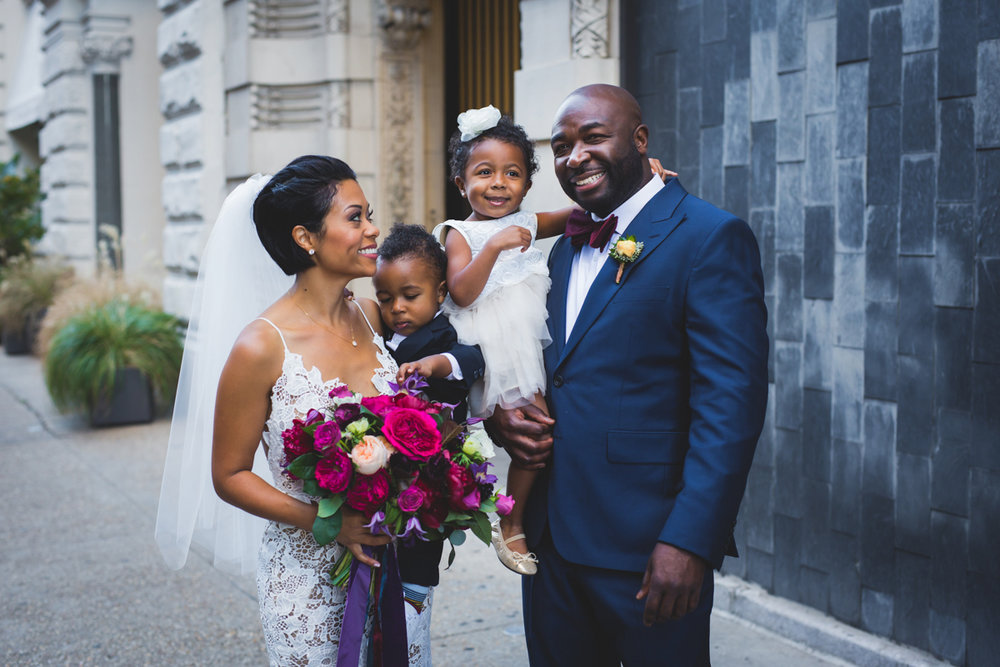 New Orleans Destination Wedding couple holding small children outside