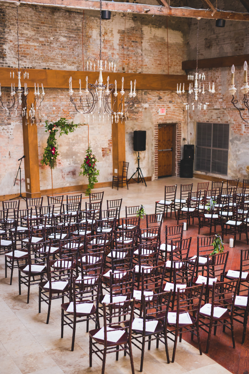 New Orleans Destination Wedding ceremony room with copper pipe altar
