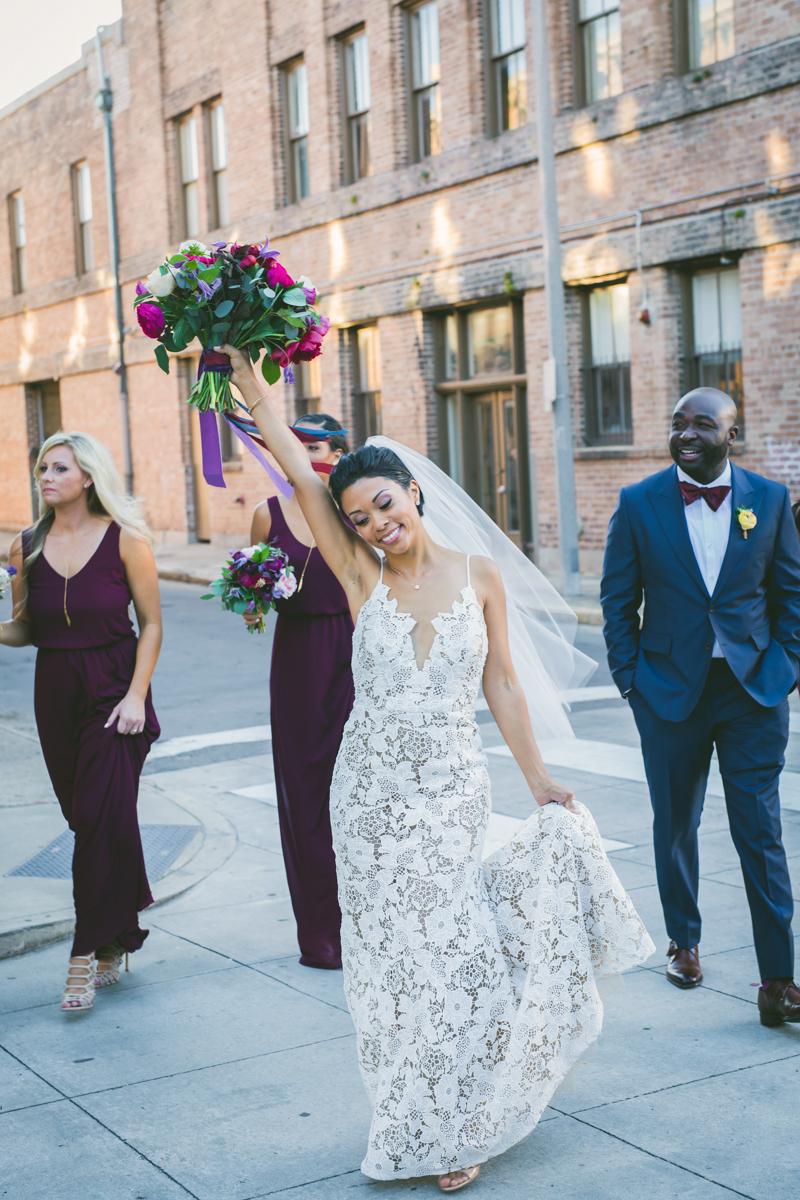 New Orleans Destination Wedding wedding party walking on sidewalk, jessica happily holding up bouquet