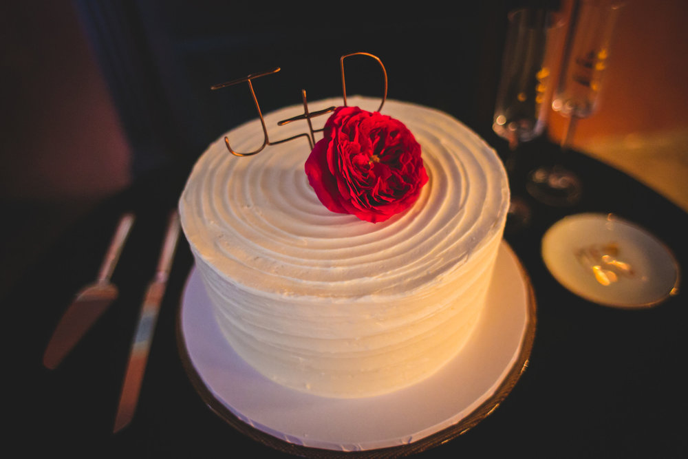 """New Orleans Destination Wedding wedding cake with flower and copper wire cake topper reading """"j + d"""""""