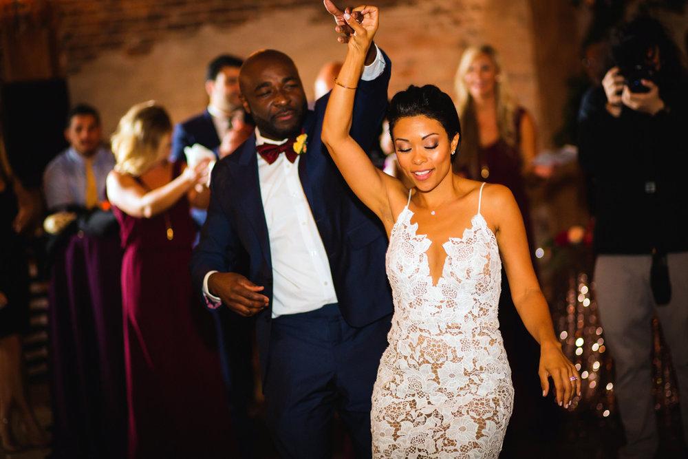 New Orleans Destination Wedding groom twirling bride on dance floor