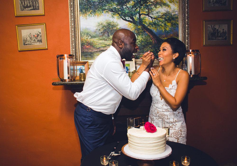 New Orleans Destination Wedding couple feeding each other wedding cake