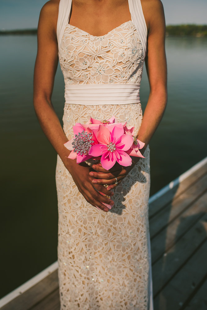 wedding inspiration the boathouse at sunday park midlothian virginia bride holding jewel-and-paper bouquet on dock