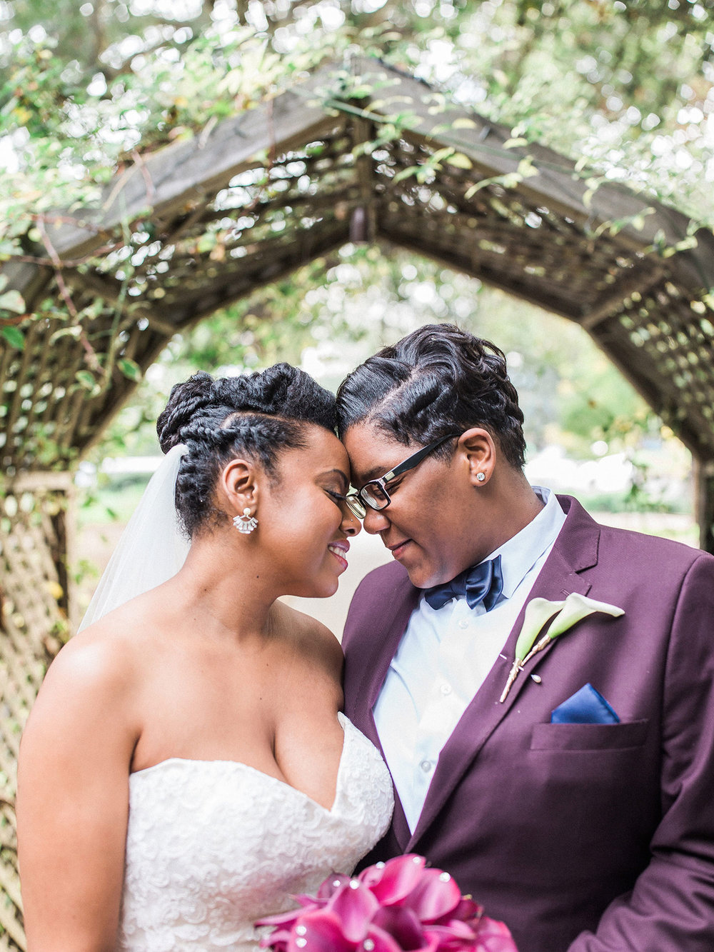 Newlywed couple smiling and touching foreheads together under tree Apollo Fotografie San Francisco California