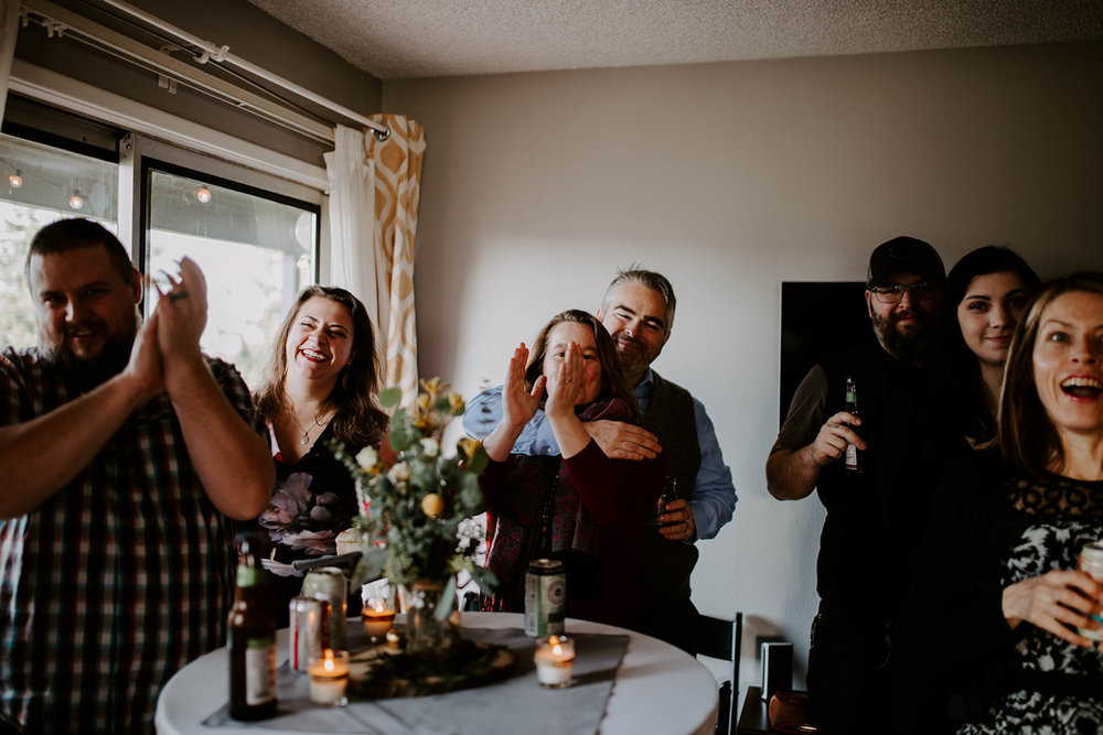 queer surprise home wedding guests clapping