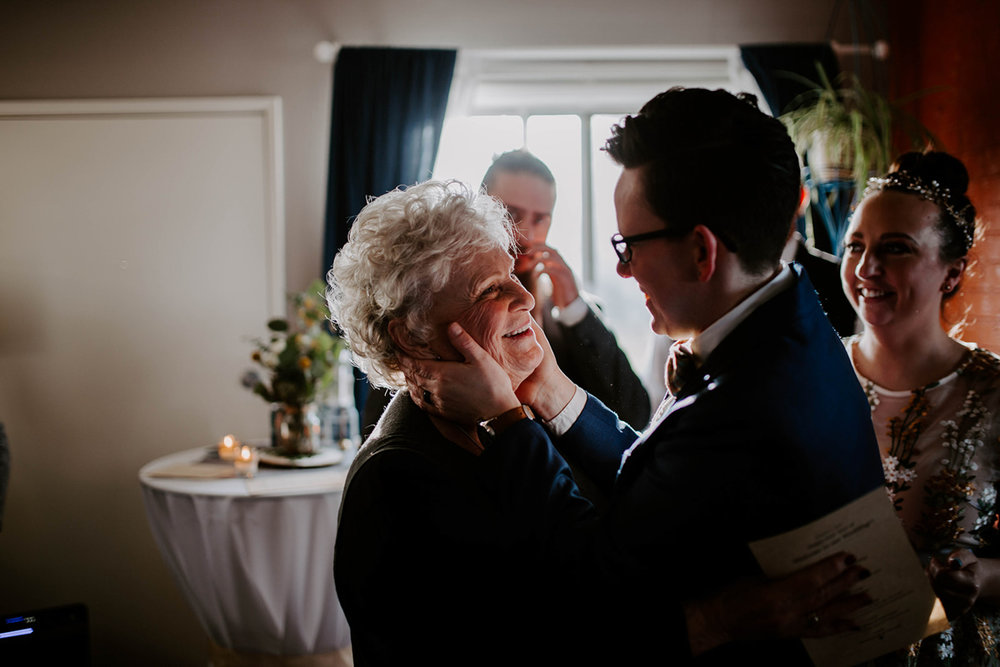 queer surprise home wedding andi greeting grandmother after ceremony