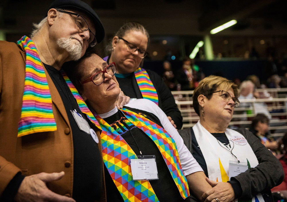 Members of the United Methodist Church look on with dismay after vote. Associated Press