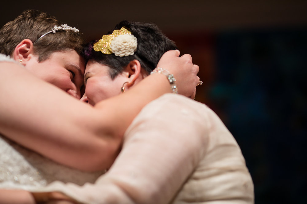 two brides embraced and touching noses right after exchanging vows at their wedding ceremony Meera Graham Photography Missoula Montana