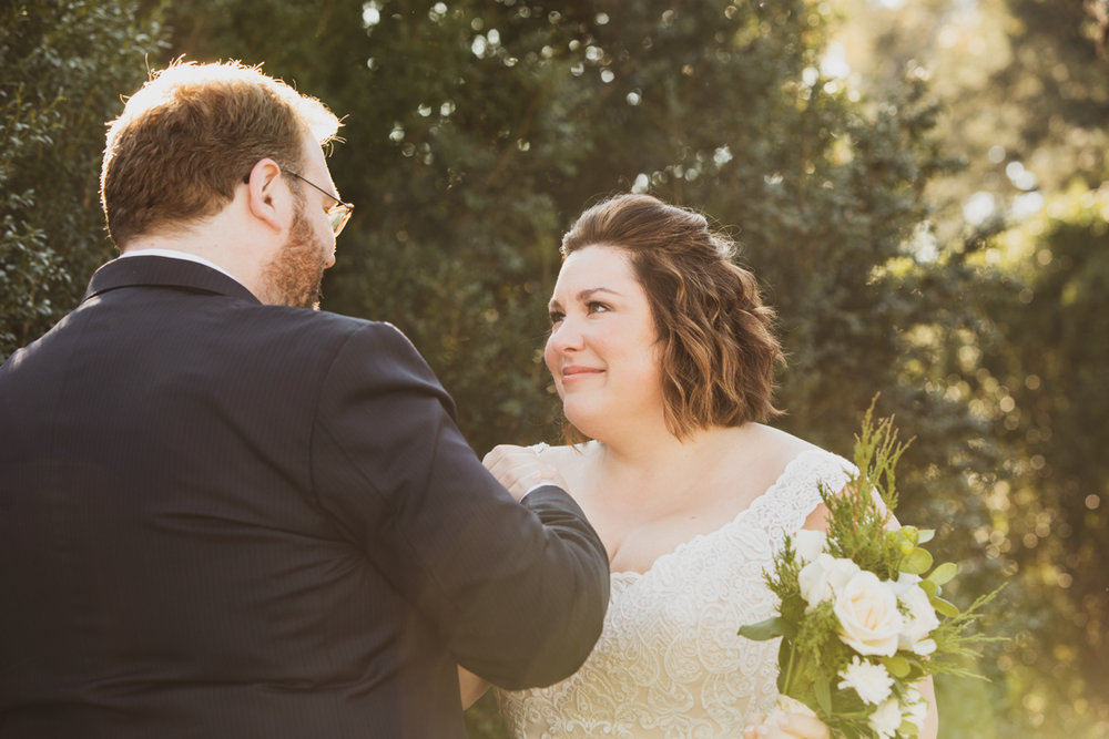 Romantic, Intimate-Feeling Wedding first look in garden with dreamy sunset light