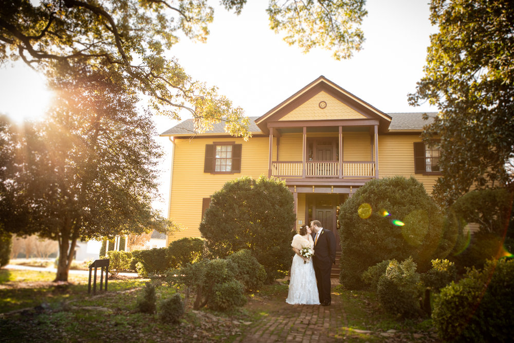 Romantic, Intimate-Feeling Wedding kiss in front of house