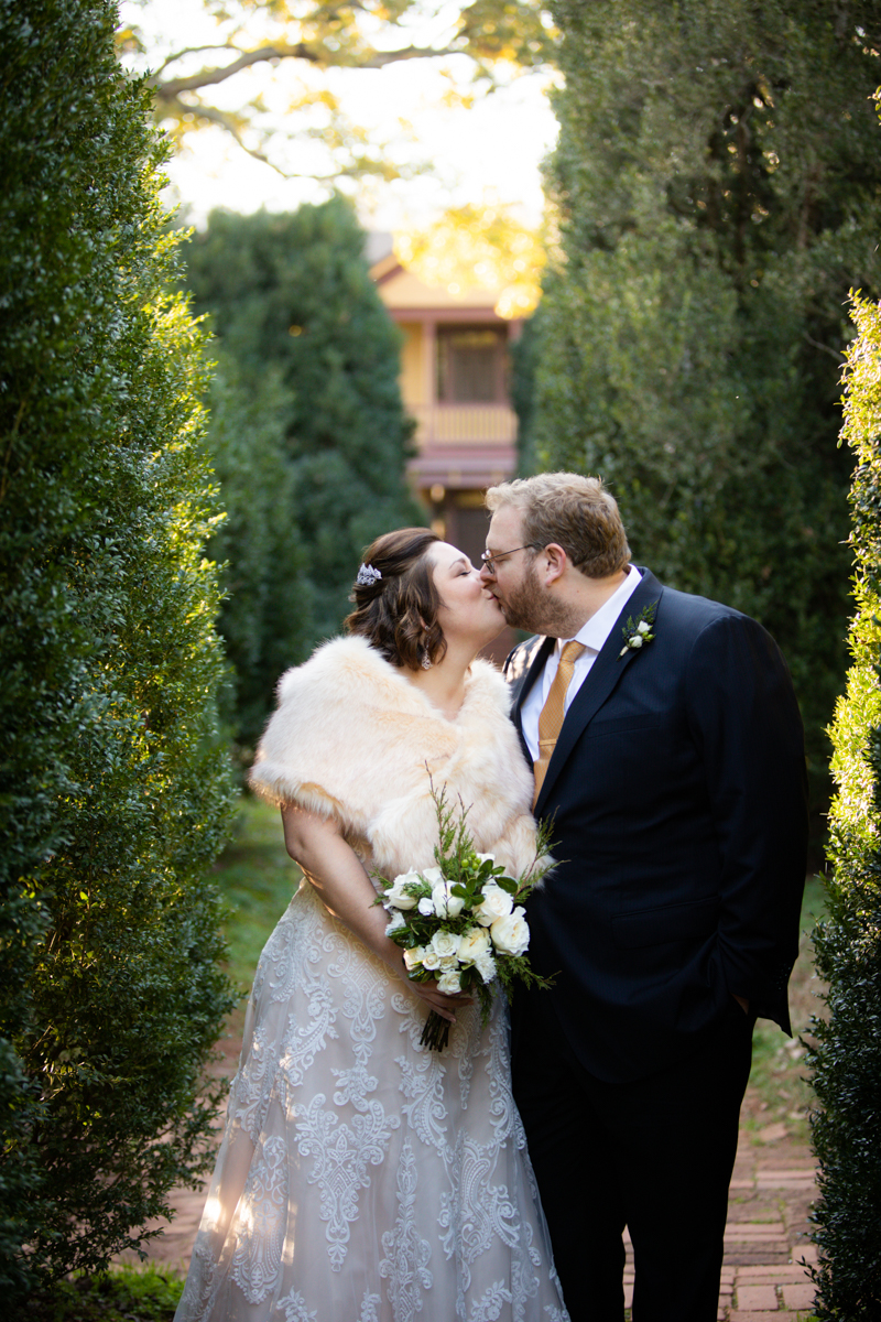 Romantic, Intimate-Feeling Wedding kiss on brick path