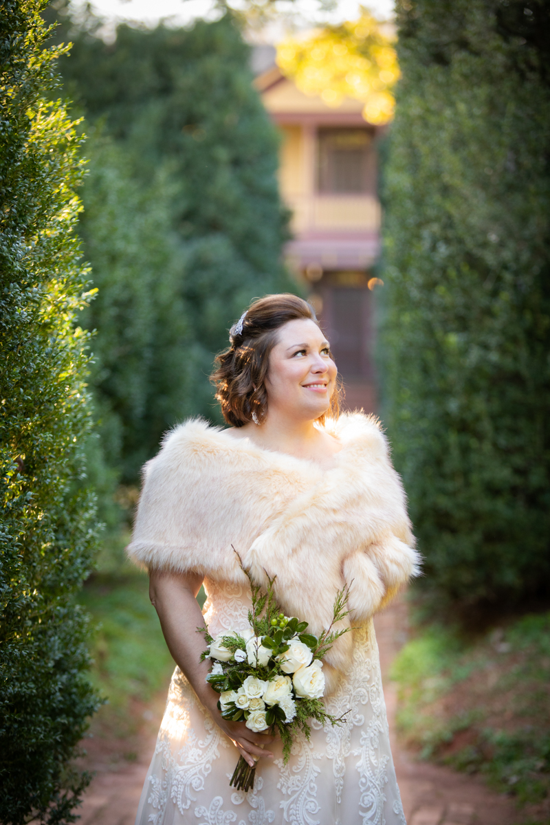 Romantic, Intimate-Feeling Wedding caroline on tree-lined brick path wearing fur shawl