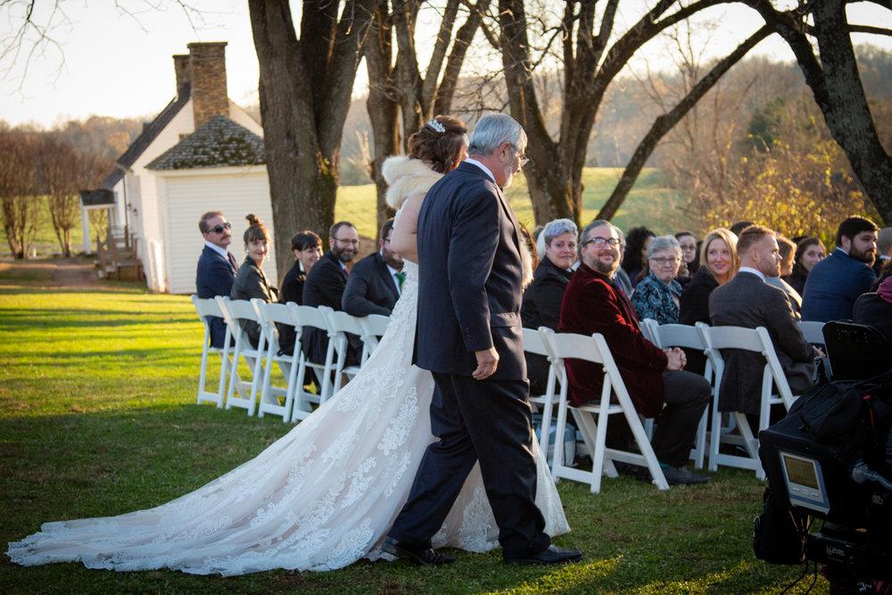 Romantic, Intimate-Feeling Wedding caroline walking down aisle in garden