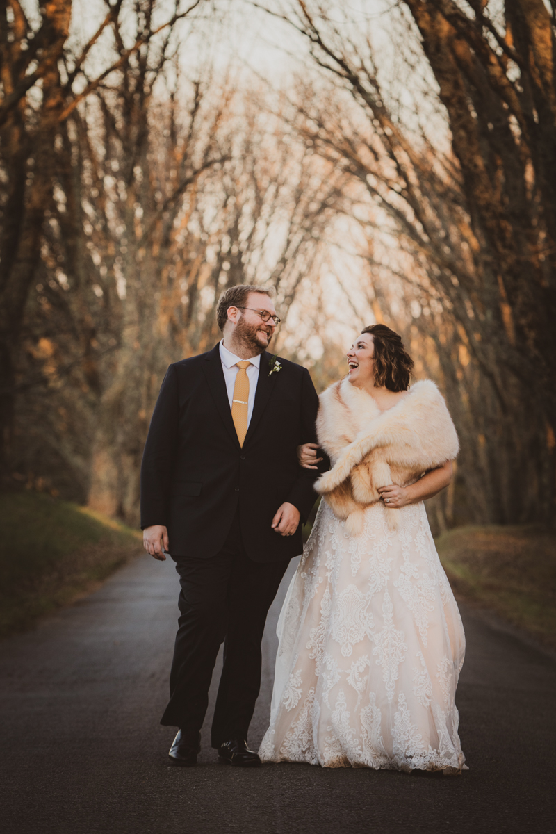 Romantic, Intimate-Feeling Wedding couple walking on park path lined with trees