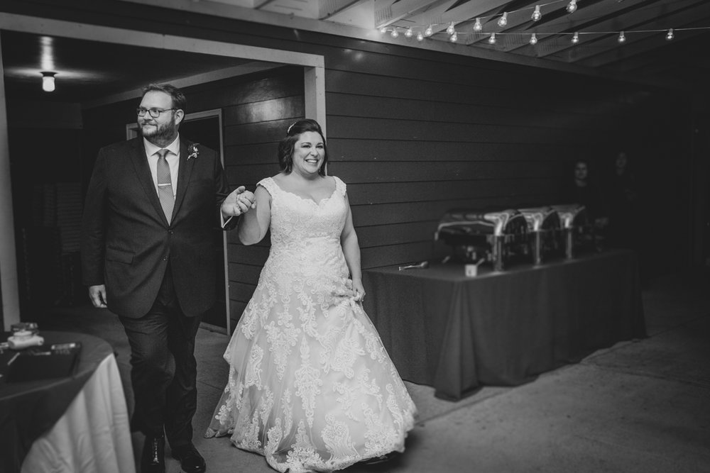Romantic, Intimate-Feeling Wedding caroline and jon entering reception
