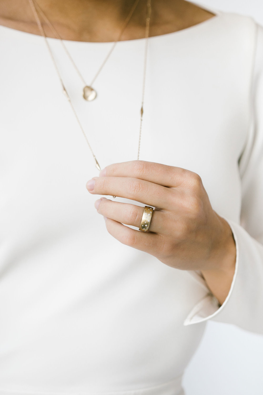 diamond celestial ring, medium diamond sculpted disc pendant, and sculpted pod necklace