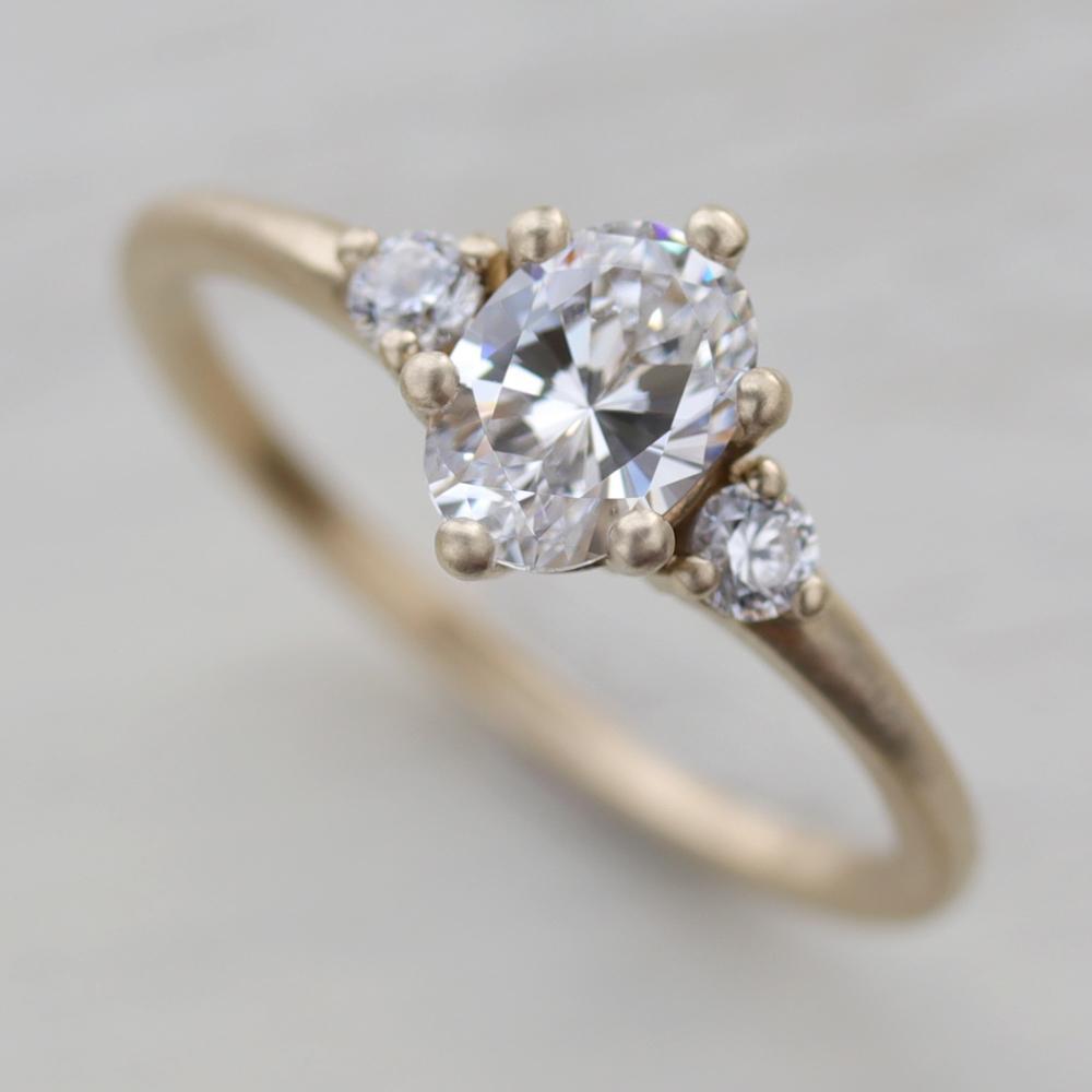 Prong-set Oval Three Stone Engagement Ring