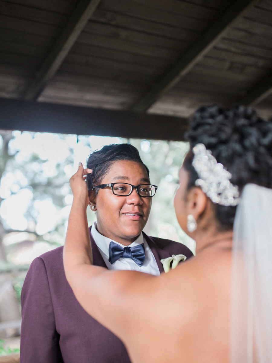 los altos lutheran same-sex wedding first look tasha smoothing back alexis's hair