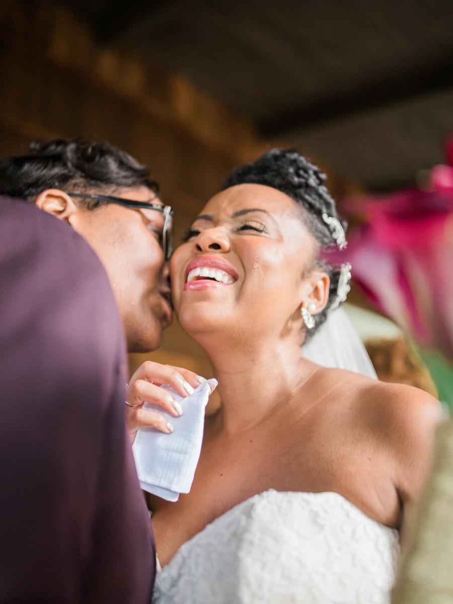 los altos lutheran same-sex wedding kiss on cheek as tasha holds handkerchief for happy tears