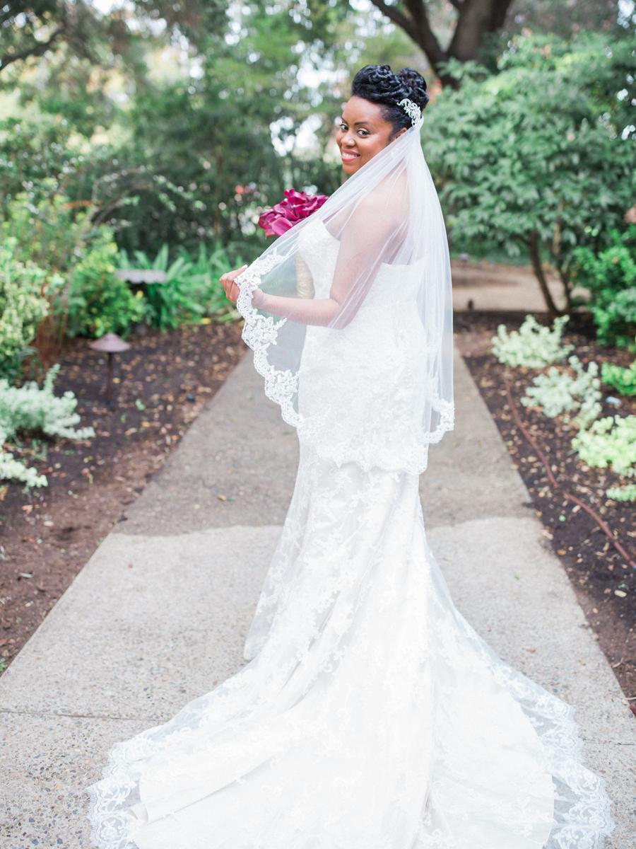 los altos lutheran same-sex wedding tasha modeling dress on garden path