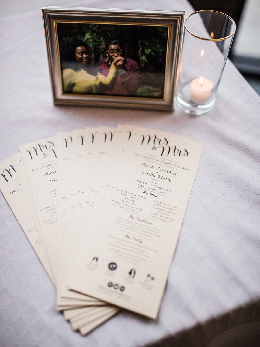 los altos lutheran same-sex wedding table with tea candle, picture of couple, and ceremony schedule