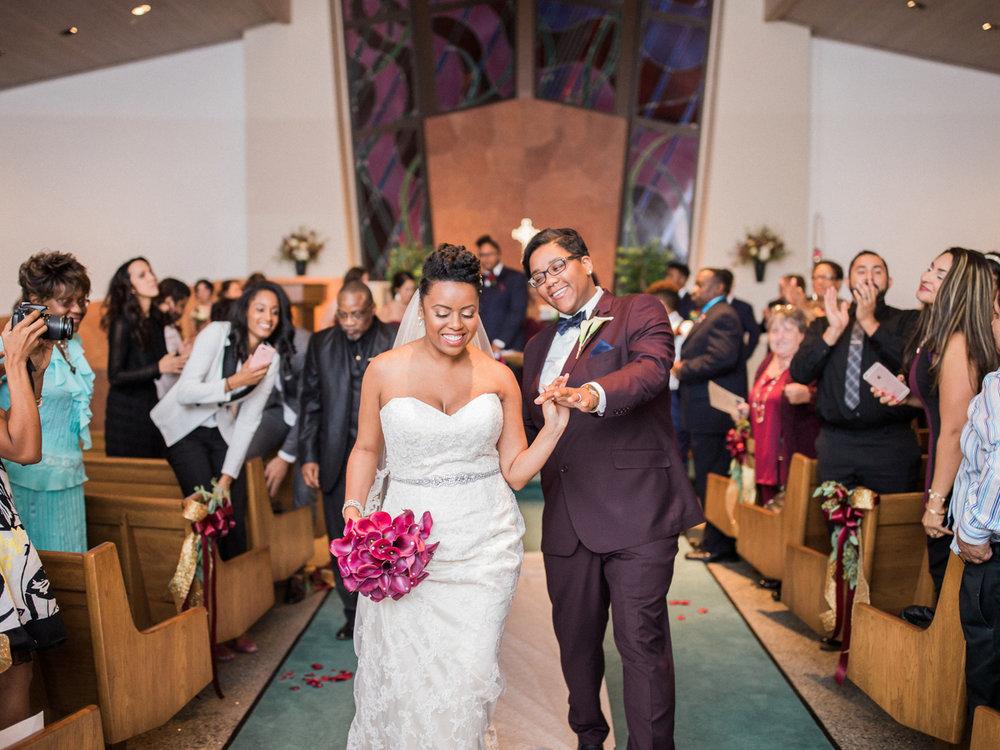 los altos lutheran same-sex wedding newlyweds walking down aisle