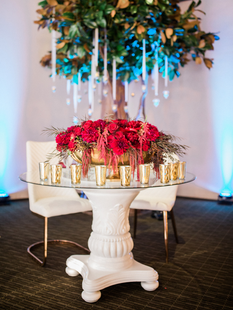 los altos lutheran same-sex wedding elegant table with large floral centerpiece and gold glasses